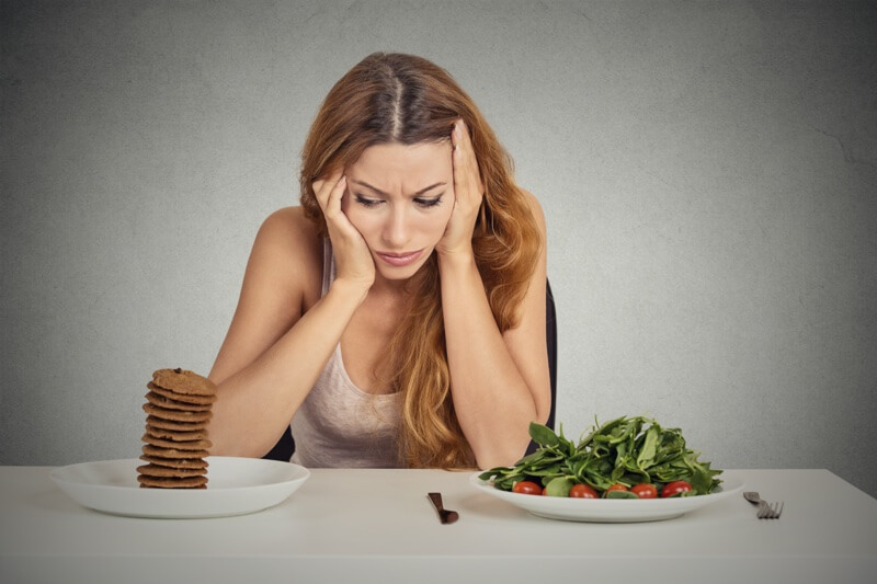 lady contemplating dessert vs salad to represent nutrition how it relates to your brain speaking topic