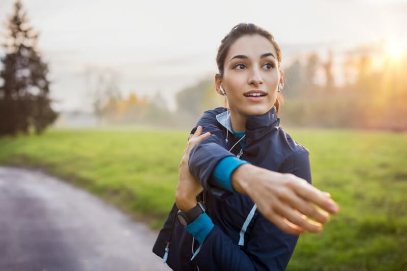 lady stretching arm in outdoors to represent cerebral trip speaking topic